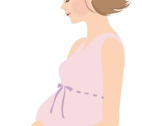 おなかに手を当てる妊婦